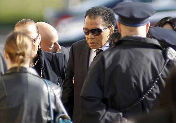 Boxing great Muhammad Ali enters the funeral for boxer Joe Frazier at the Enon Tabernacle Baptist church in Philadelphia