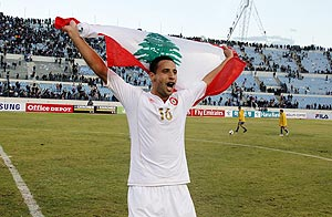 Lebanon's Bilal al-Sheikh Najjarine celebrates after his team beat South Korea in their 2014 World Cup qualifier