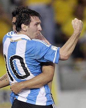 Argentina's Sergio Aguero celebrates with teammate Lionel Messi (10) after he scored the team's second goal against Colombia