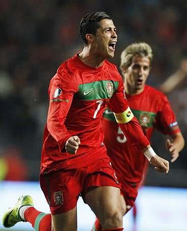 Cristiano Ronaldo of Portugal celebrates after scoring against Bosnia during their Euro 2012 play-off second leg qualifier on Tuesday