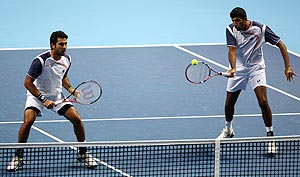 Rohan Bopanna and Aisam-Ul-Haq Qureshi in action against against Max Mirnyi and Daniel Nestor during the men's doubles first round match of the World Tour Finals on Sunday