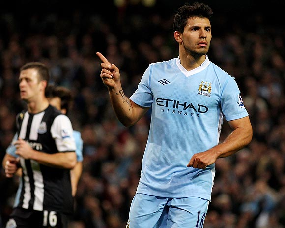 Sergio Aguero celebrates after scoring against Newcastle