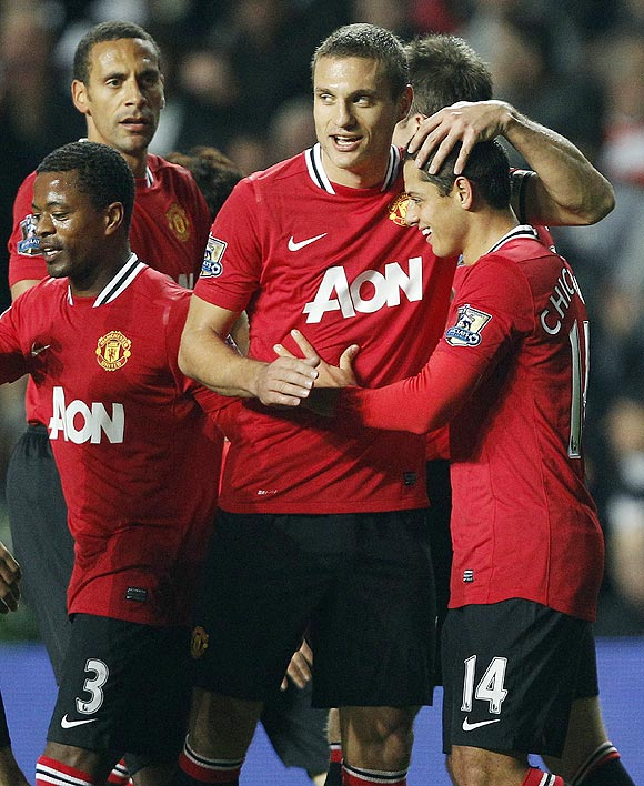 Manchester United's Javier Hernandez (right) celebrates with teammates after scoring against Swansea City