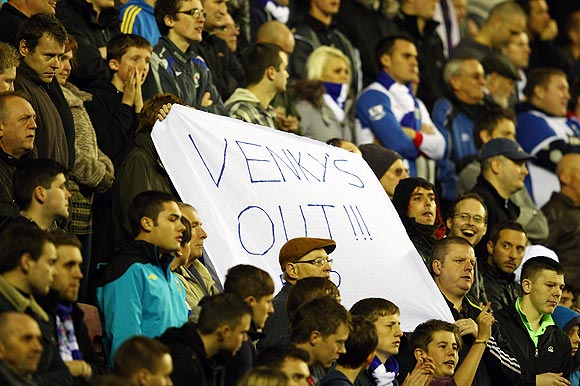 Blackburn fans protest against club owners Venky's and manager Steve Kean during their match between Wigan Athletic on Saturday