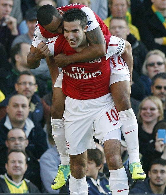 Arsenal's Robin Van Persie (right) celebrates with teammate Theo Walcott after scoring against Norwich City