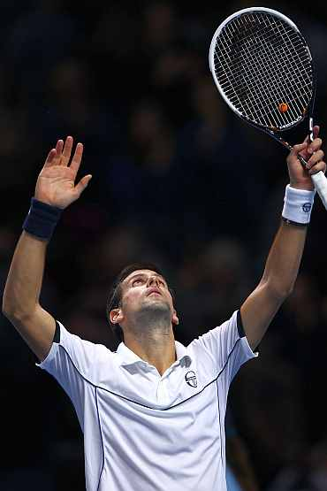 Novak Djokovic celebrates after winning his match against Tomas Berdych