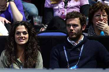 Chelsea's Juan Mata watches the men's singles first round match between Novak Djokovic and Tomas Berdych