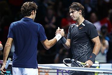 afael Nadal greets Roger Federer