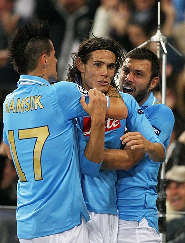 Edinson Cavani (centre) of Napoli celebrates with his team-mates scoring the opening goal against Manchester City FC at Stadio San Paolo on Tuesday