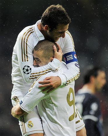Karim Benzema (right) of Real Madrid celebrates scoring with his team-mate Gonzalo Higuain