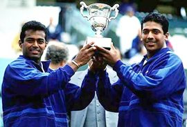 Leander Paes and Mahesh Bhupathi after their triumph at the French Open in 1999