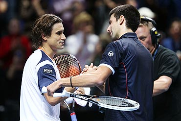 David Ferrer (left) greets Novak Djokovic