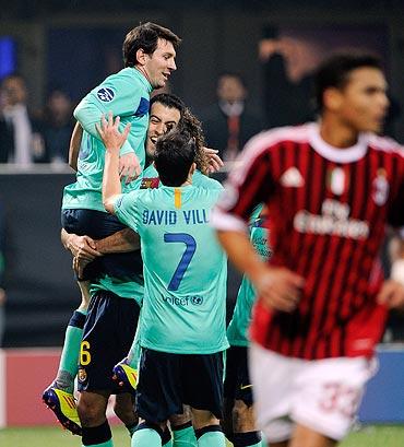 Messi celebrates his goal with team-mates