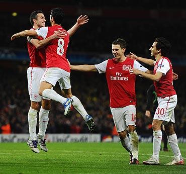 Robin van Persie celebrates goal with team-mates