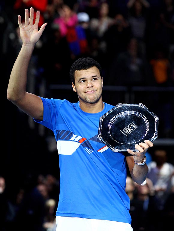 Jo-Wilfried Tsonga holds his runners up trophy after losing to Roger Federer