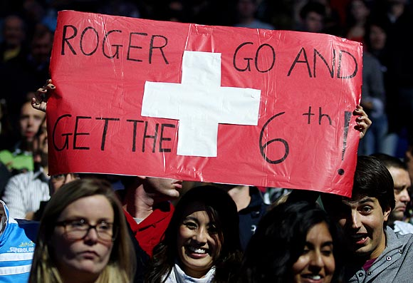 Roger Federer's fans hold up a placard during the World Tour finals on Sunday