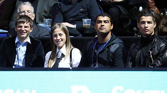 Arsenal footballer Andrey Arshavin (left) his wife, Yulia (2nd from left), Real Madrid's Cristiano Ronaldo (right) and a friend watch the  World Tour finals on Sunday