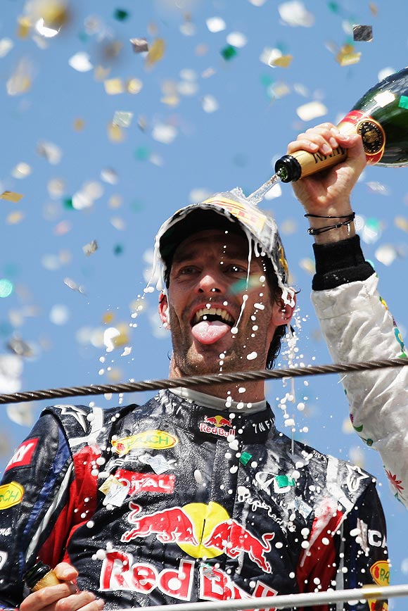 Red Bull's Mark Webber celebrates on the podium after winning the Brazilian Grand Prix on Sunday