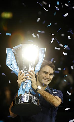 Roger Federer with the World Tour Finals trophy