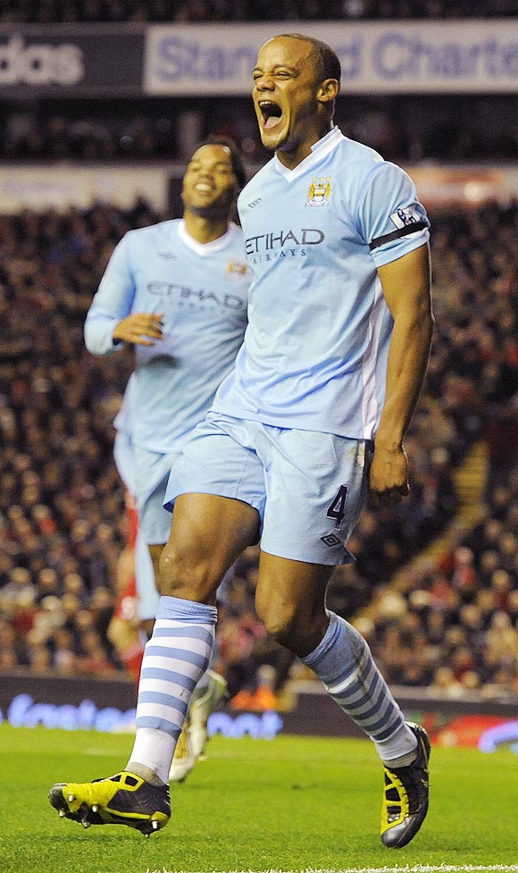Manchester City's Vincent Kompany (right) celebrates after scoring against Liverpool