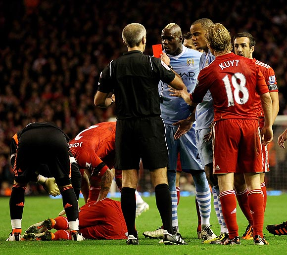 Mario Balotelli of Manchester City is shown a red card by Referee Martin Atkinson