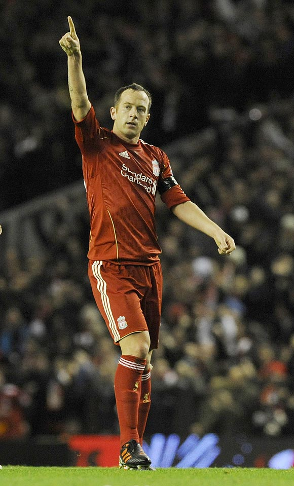 Liverpool's Charlie Adam celebrates after his shot was deflected into the goal by Manchester City's Joleon Lescott