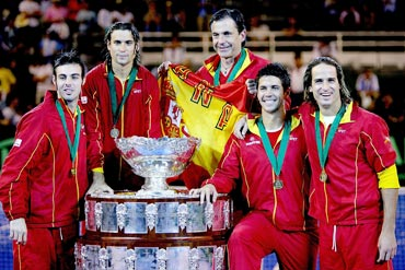 Members of the Spanish team, Marcel Granollers, David Ferrer, head coach Emilio Sanchez, Fernando Verdasco and Feliciano Lopez, pose for photographers after defeating Argentina 3-1 in the Davis Cup final in 2008