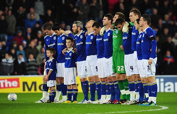 The Cardiff team observe the minute's silence in memory of Gary Speed before their Carling Cup quarter-final against Blackburn Rovers on Tuesday