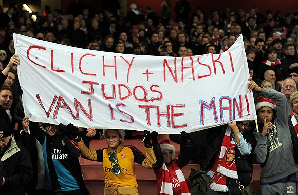 Arsenal fans hold up a banner berating former players Clichy and Nasri prior to their Carling Cup quarter-final against Manchester City on Tuesday