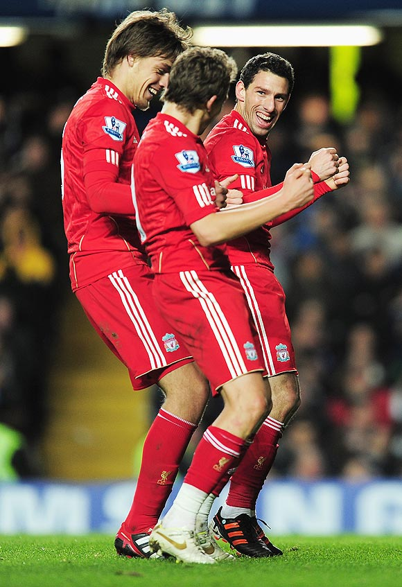 Liverpool's Maxi Rodriguez (right) breaks into a jig as he celebrates with teammates after scoring the opening goal during the Leagur Cup quarter-final against Chelsea on Tuesday
