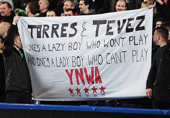 Liverpool fans hold up a banner during the League Cup quarter-final between Chelsea and Liverpool on Tuesday