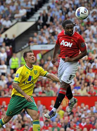 Manchester United's Anderson heads the ball into the goal against Norwich City