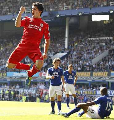 Liverpool's Luiz Suarez celebrates after scoring against Everton