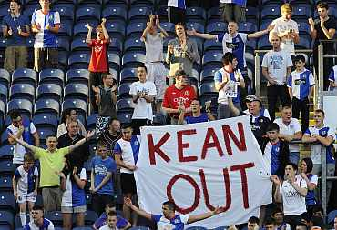 Fans of Blackburn Rovers protest after their match against Manchester City