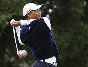 Tiger Woods makes a tee shot on the second hole during the first round of the Frys.com Open on Thursday