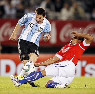 Argentina's Messi fights for th