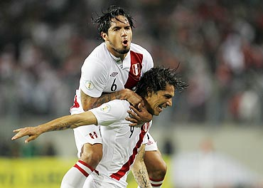 Peru's Paolo Guerrero (right) celebrates with team-mate Juan Vargas after scoring against Paraguay during their 2014 World Cup qualifying football match