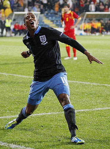 England's Ashley Young celebrates scoring against Montenegro during their Euro 2012 Group G qualifying match