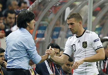 Germany's Lukas Podolski (right) is congratulated by head coach Joachim Loew during their Euro 2012 qualifying Group A match