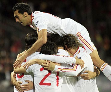Spain national football team players celebrate against the Czech Republic during their Euro 2012 Group I qualifying football match