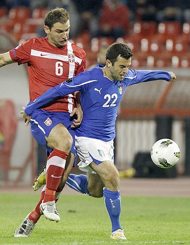 Giuseppe Rossi (22) of Italy challenges Branislav Ivanovic of Serbia during their Euro 2012 Group C qualifying football match