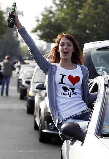 A motor racing fan celebrates in Heppenheim, Germany, after a public viewing of the Suzuka Grand Prix on Sunday