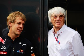 F1 supremo Bernie Ecclestone (right) talks with Sebastian Vettel