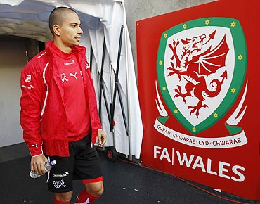 Switzerland's captain Gokhan Inler arrives for a team training session