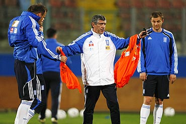 Greece head coach Fernando Santos (centre) runs a training session