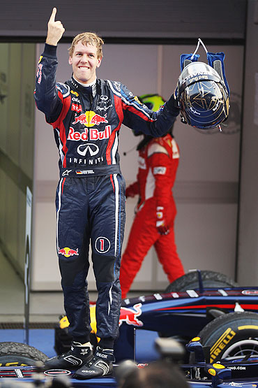 Sebastian Vettel of Red Bull celebrates in parc ferme after winning the Korean Form