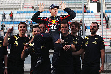 Sebastian Vettel celebrates with team-mates as they win the Constructors title following his victory in the Korean Formula One Grand Prix