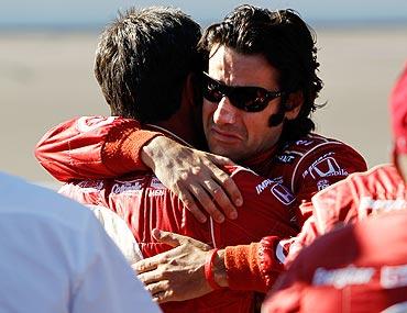 Dario Franchitti, driver of the 10 Target Chip Ganassi Racing Dallara Honda hugs a crew member after the death of Dan Wheldon