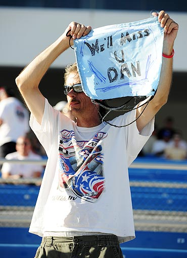 A fan waves a sign after Dan Wheldon died of injuries after a fifteen car crash during the Las Vegas Indy 300 part of the IZOD IndyCar World Championships
