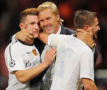 Thorsten Fink ex-manager of Basel celebrates with Taulant Xhaka (left) and Markus Steinhofer (right)